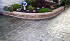 Stamped Concrete Patio and Masonry Retaining Wall
